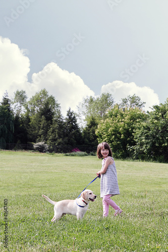 Little Girl Walking her Puppy
