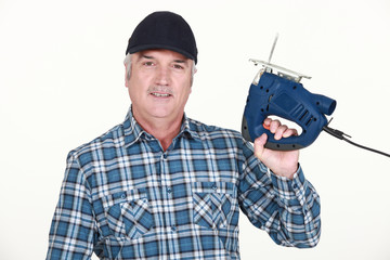 Handyman holding a jigsaw