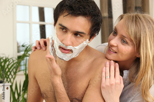Man shaving in his bathroom