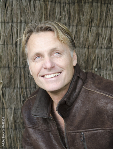 happy smiling mature man with blond hair