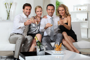 Two couples drinking champagne