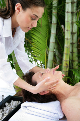 Mature woman having facial massage