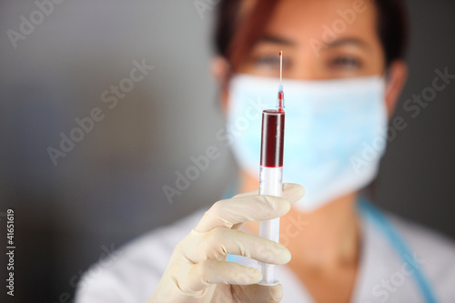Woman taking blood sample