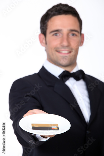 Waiter giving back credit card