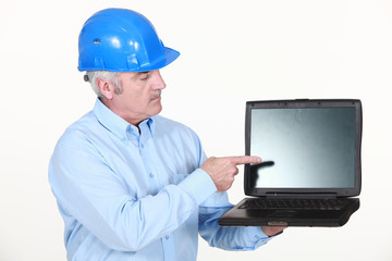 Architect pointing at laptop