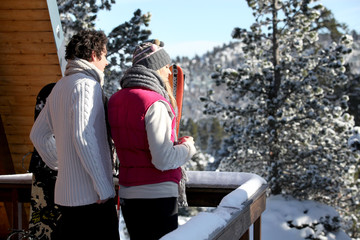 Couple arriving at their winter chalet