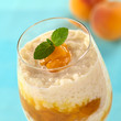 Rice pudding with peach compote garnished with mint