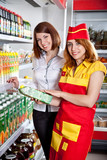 The seller and the buyer in grocery shop poster