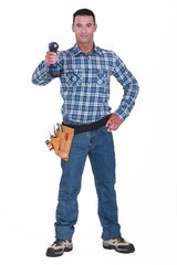 Tradesman aiming his power tool