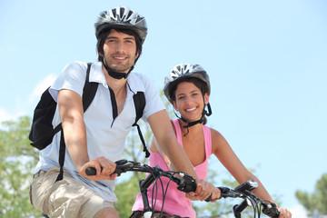 Couple on bicycle helmet