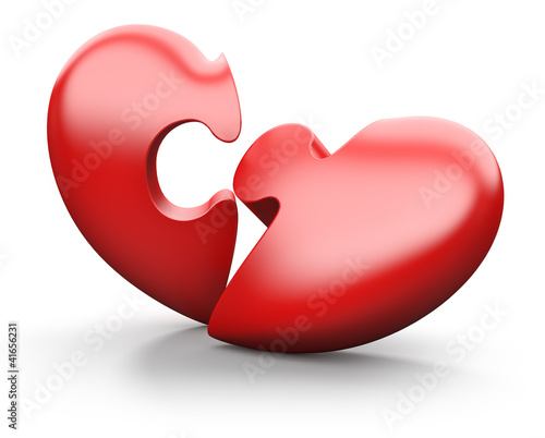 Broken jigsaw heart, isolated on white