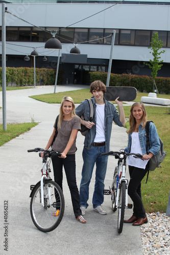 Young people with bicycles and skateboard