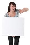 young woman pointing at a blank board