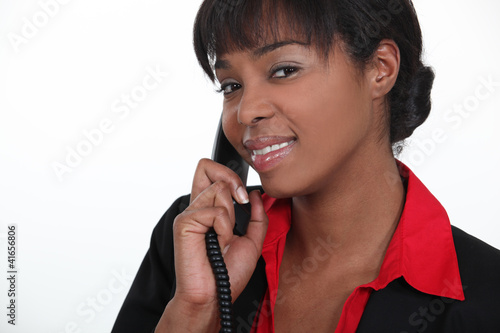 Receptionist answering a telephone