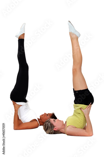 Young women performing shoulder stands