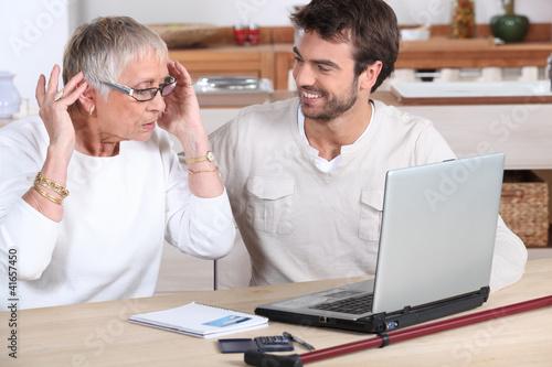 elderly woman using computer