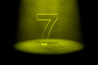 Number 7 illuminated with yellow light