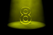 Number 8 illuminated with yellow light