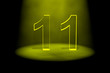Number 11 illuminated with yellow light