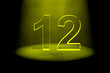 Number 12 illuminated with yellow light