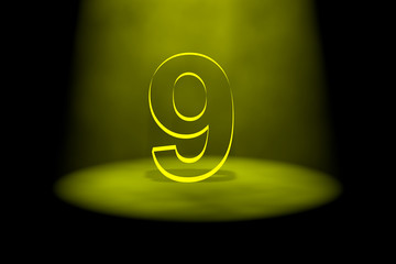 Number 9 illuminated with yellow light