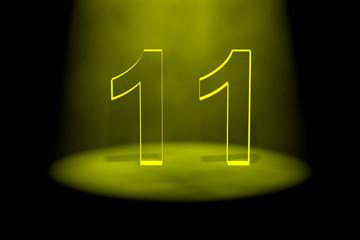 Number 11 illuminated with yellow light