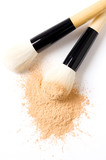 closeup of face powder and brush isolated