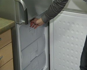 refrigerator cabinet drawer closing. product demonstration store