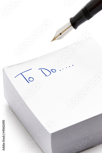To do list written on post it note pad