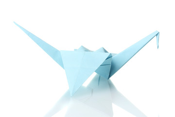 Origami crane  out of the blue paper isolated on white
