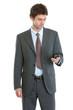 Modern businessman checking mobile phone
