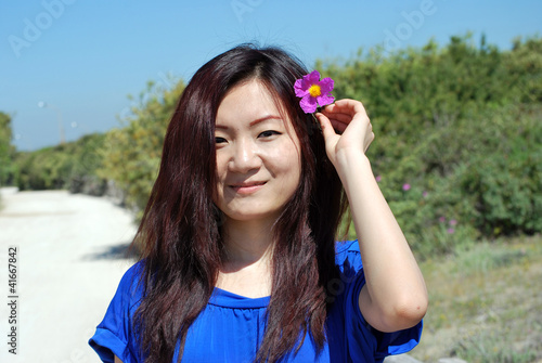 Asian girl  with the purple flower