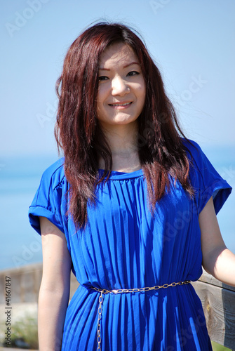 Asian girl with the blue dress in the dunes 2