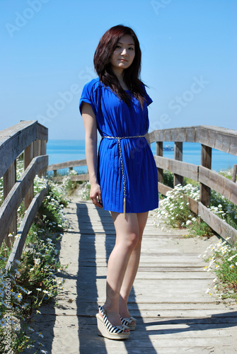 Asian girl  with the blue dress in the dunes 1