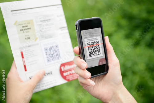 Leinwanddruck Bild Scanning QR code on mobile phone