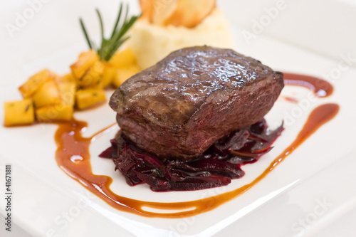 Fillet steak sitting over red braised cabbage