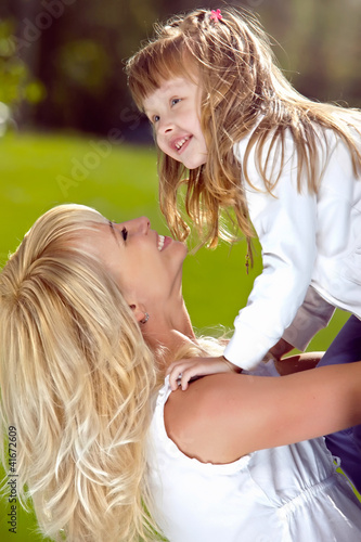 Mother playing with her daughter in the park