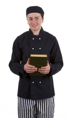 Cook holding a book