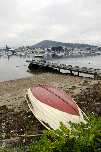 Upturned dinghy and jetty, Derwent River, Hobart, Tasmania