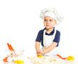 Beautiful caucasian boy making a cake