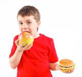 Boy eating a hamburger.