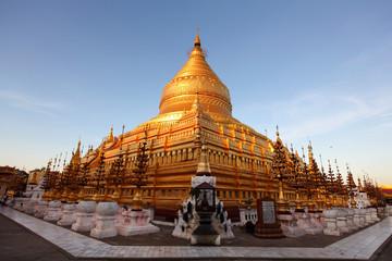 Shwezigon pagoda in Bagan, Myanmar, sunlit at sunset