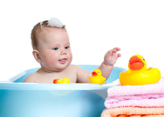 baby kid taking bath and playing