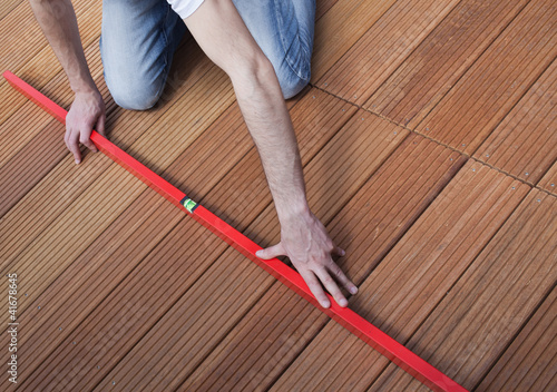 Man using spirit level on the floor