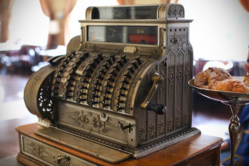 Antique cash register in a coffee shop