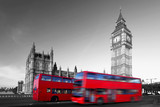 Big Ben with red city buses in London, UK