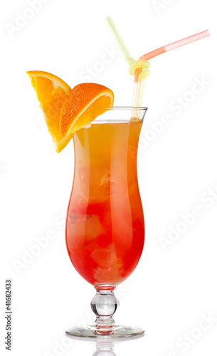 Orange alcohol cocktail with fruit slices isolated