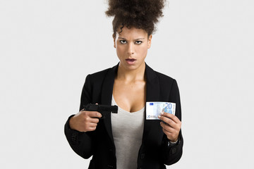 Businesswoman shooting a euro banknote