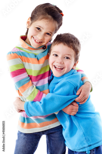 Two happy kids standing together