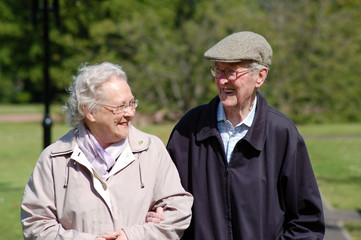 Happy senior couple strolling in the park